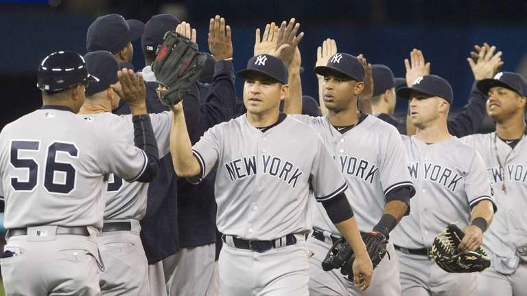 New York Yankees celebrate after defeating the Toronto