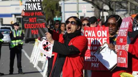 Verizon workers protest outside a Verizon depot on