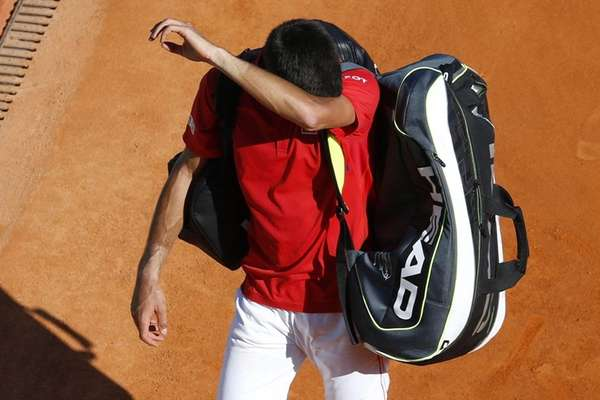 Serbia's Novak Djokovic leaves the court after