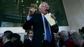 Democratic presidential candidate Bernie Sanders joins a picket