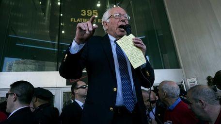 Democratic presidential candidate Bernie Sanders joins a picket
