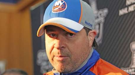 Islanders coach Jack Capuano talks to reporters