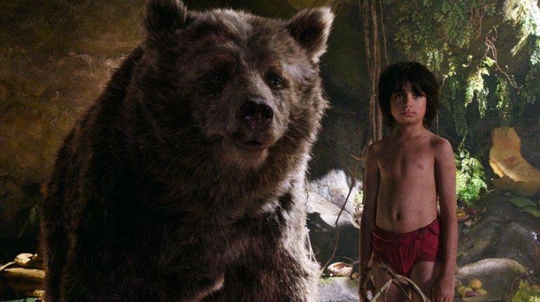 Baloo (voice of Bill Murray) and Mowgli (Neel