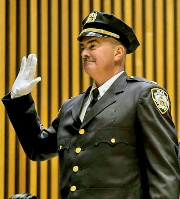 NYPD Deputy Chief Andrew Capul takes the oath