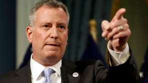 New York City Mayor Bill de Blasio gestures