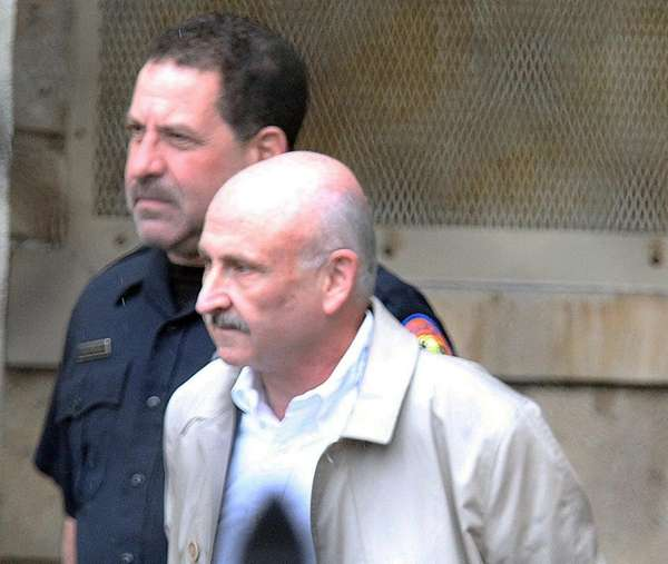 Gerard Terry leaves Nassau Police headquarters to arraigned