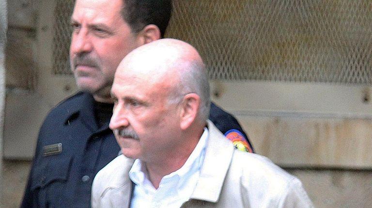 Gerard Terry leaves Nassau Police headquarters to arraigned