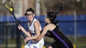Mattituck's Mackenzie Hoeg (12) moves to the goal