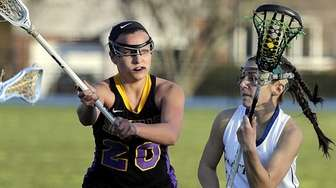 Mattituck's Ashley Hoeg (1) drives from behind the