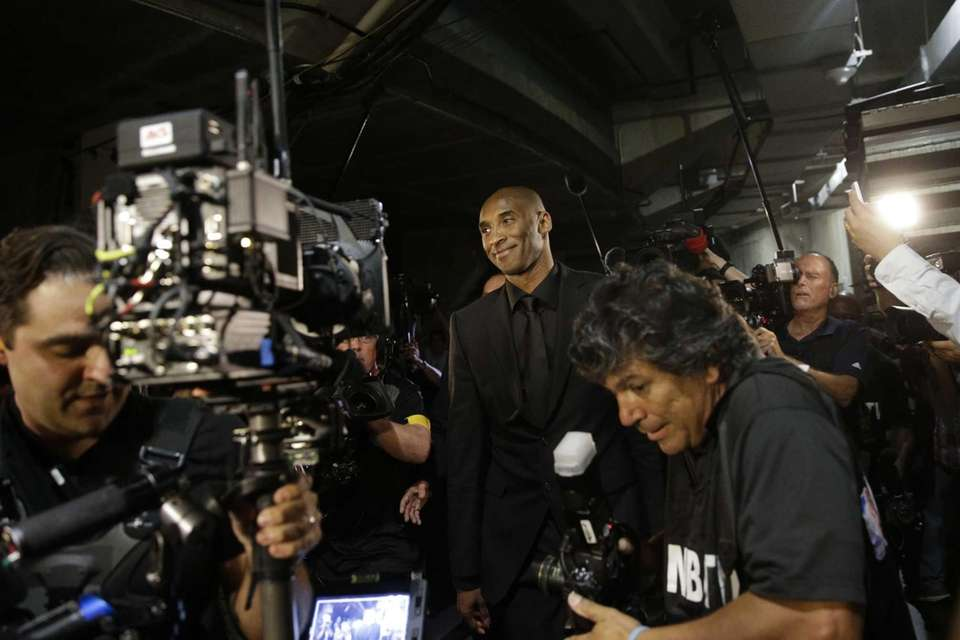 Los Angeles Lakers' Kobe Bryant smiles as he