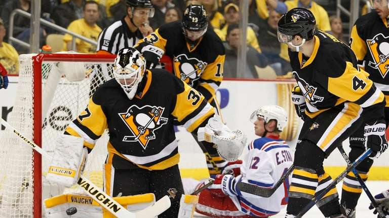 Jeff Zatkoff #37 of the Pittsburgh Penguins makes