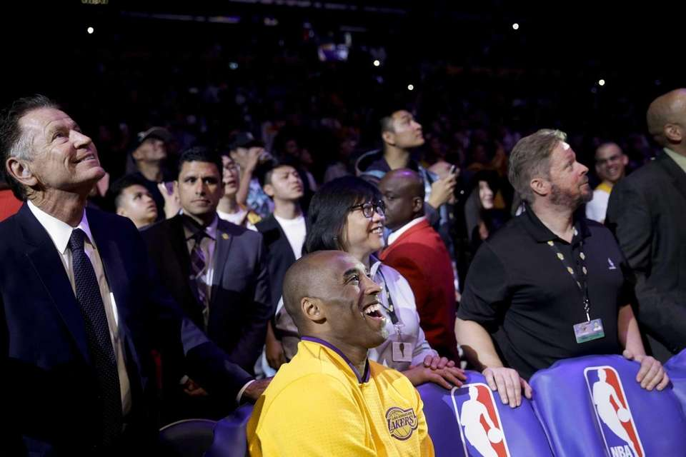Los Angeles Lakers forward Kobe Bryant watches during