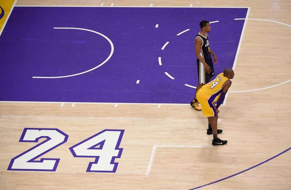Los Angeles Lakers forward Kobe Bryant, foreground, and