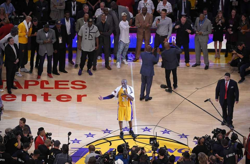 Los Angeles Lakers forward Kobe Bryant speaks to