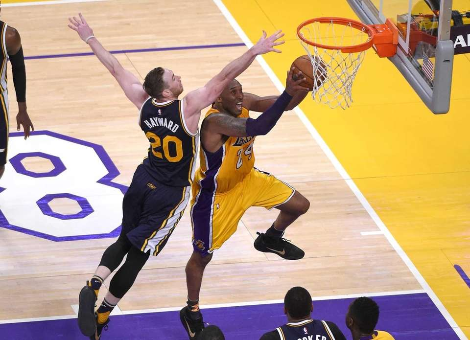 Los Angeles Lakers forward Kobe Bryant, right, shoots