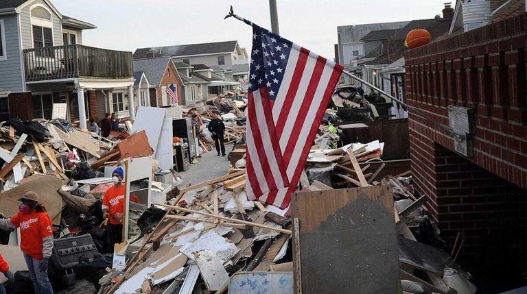 Debris is piled across Michigan Street in