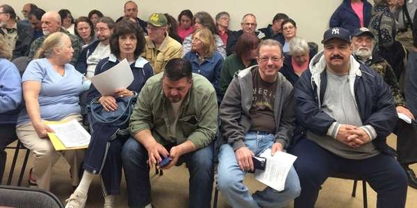 An overflow crowd attends the Mastic Beach budget