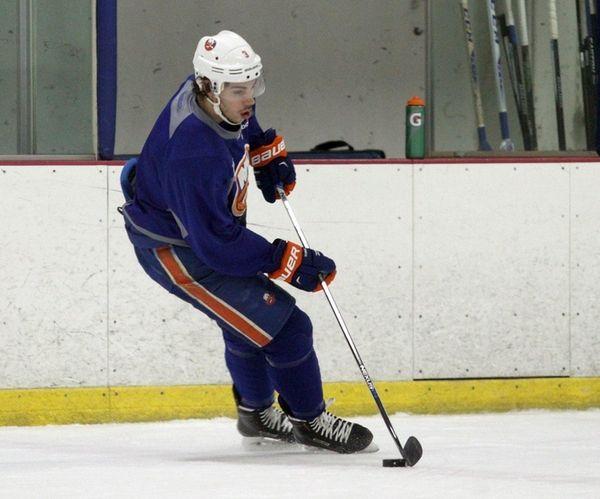 The Islanders' Travis Hamonic skates during practice