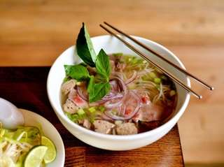 Pho bo, beef broth with rice noodles, brisket