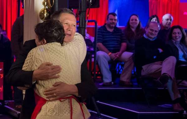 Ohio Gov. presidential candidate John Kasich hugs Maureen