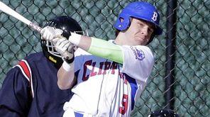 Bellport's Garrett Heaton (9) hits an RBI single