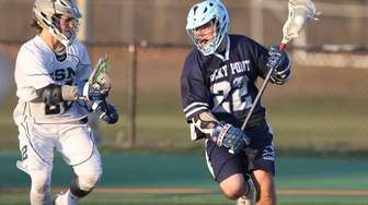 Rocky Point's Pete Lasalla (22) looks to get