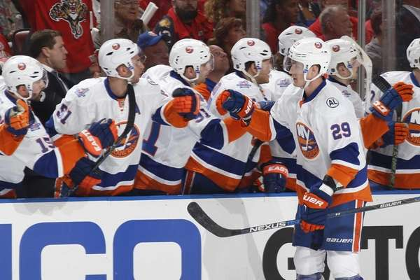 Teammates congratulate Brock Nelson of the New York