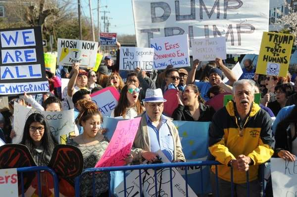 Anti-Trump protestors demonstrated outside the Emporium in Patchogue