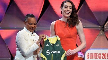 Breanna Stewart, right, and WNBA President Leslie