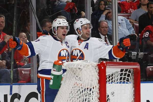 John Tavares celebrates his second-period goal with Frans