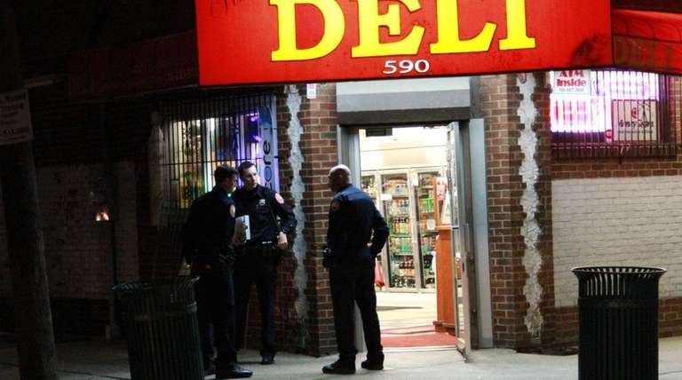 Nassau County police investigate an armed robbery at