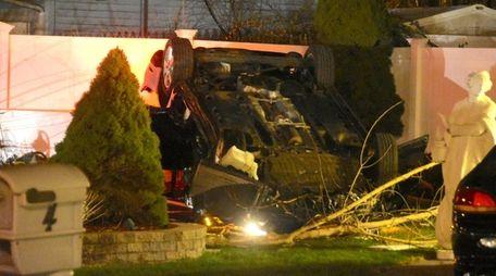 A Volkswagen sedan is seen overturned on a