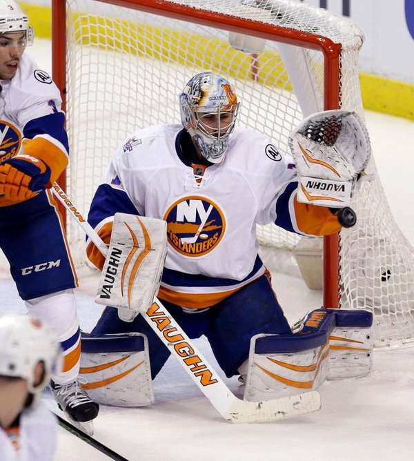 New York Islanders goalie Thomas Greiss stops