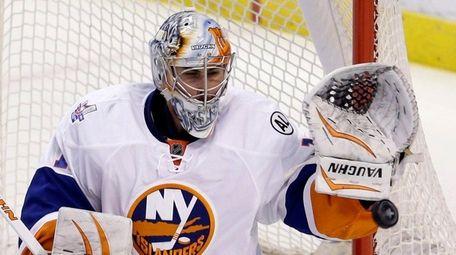 New York Islanders goalie Thomas Greiss stops