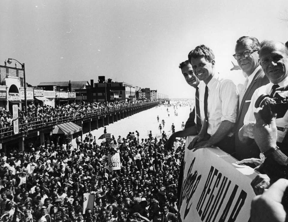 Robert F. Kennedy stands atop a platform overlooking