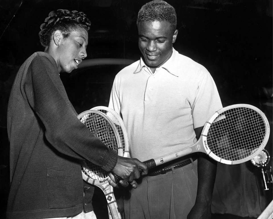 Tennis great Althea Gibson shows baseball legend Jackie