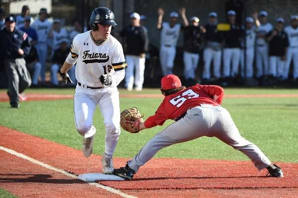 St. Anthony's Cameron Tomaiko is safe at first
