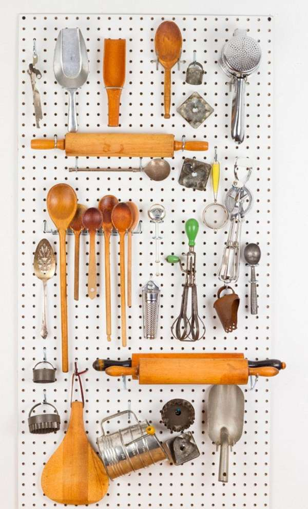 Use a pegboard to organize your kitchen utensils.