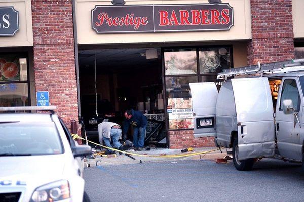 A sport utility vehicle barreled into Prestige Barbers