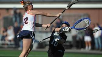 Erin Barry #2 of Manhasset, left, tries to