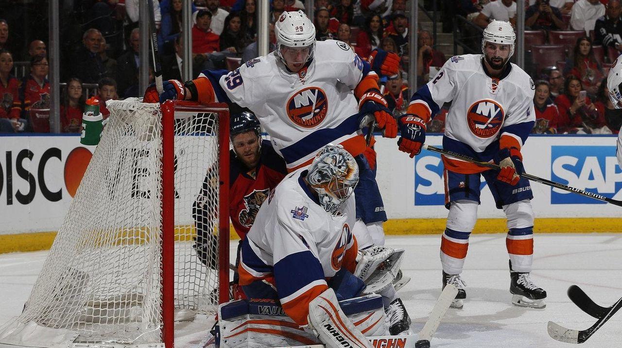 Islanders' Thomas Greiss defends against a shot
