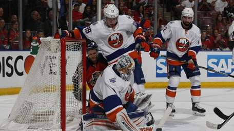 Islanders' Thomas Greiss defends against a shot