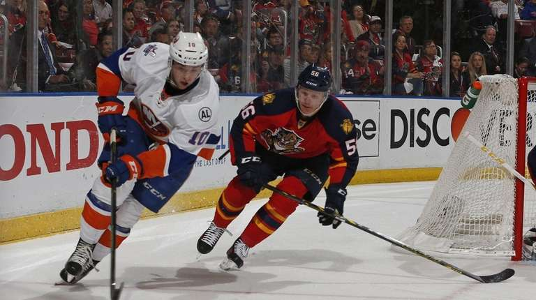 Islanders' Alan Quine tries to maintain control of