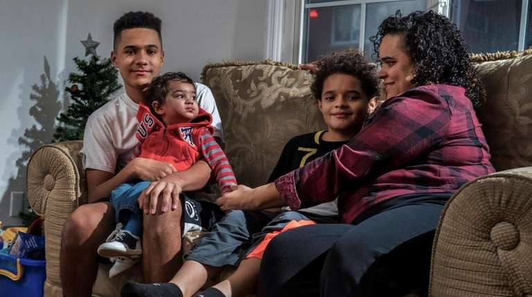 Elena Rios, 37, with her sons, from left,