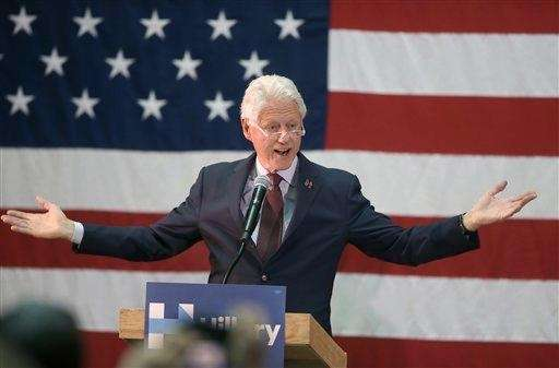 Former President Bill Clinton addresses an audience while