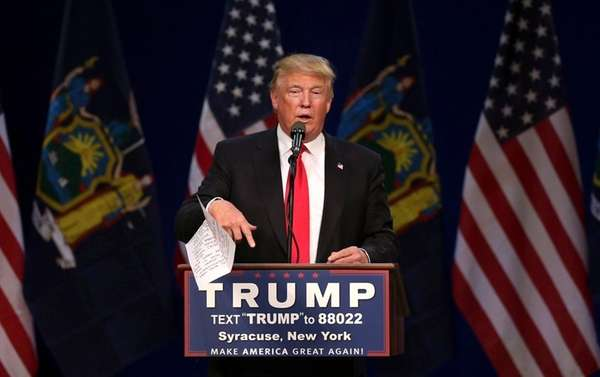 Republican presidential candidate Donald Trump tosses his speech