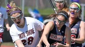 North Shore's Frankie Conklin works against MacArthur's Marisa
