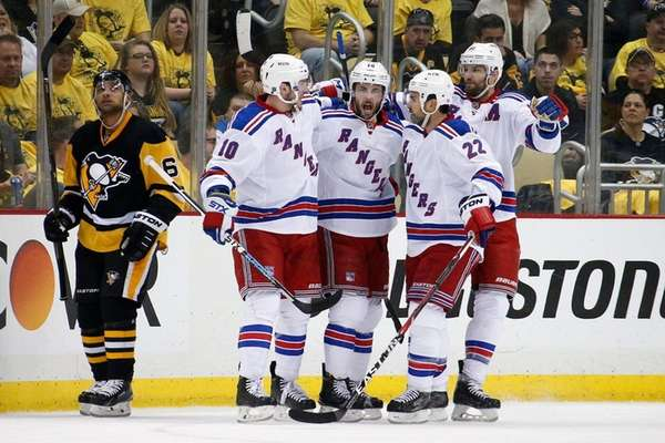 New York Rangers' Derick Brassard (16) celebrates his