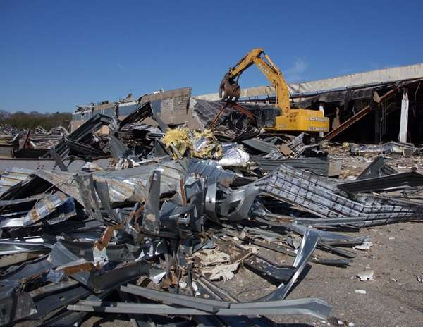 A contractor demolishes the long-vacant Kmart building in