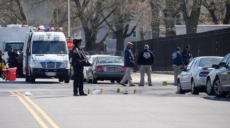 NYPD investigators at the scene in South Ozone